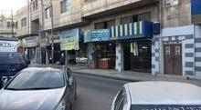 محل طابقين في وسط تجاري مربع البنك الاسلامي في الزرقاء