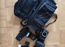Nikon D5200 black body with 18-140 nikkor lens, 14-55 Nikon lens, SB-600 Nikon flash, camera bag