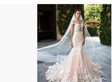 فستان عرس ميلا نوفا اصلي من امريكا.