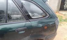 Mazda 323 2002 For sale - Green color