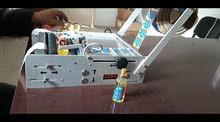 آلة وضع الملصقات على القوارير,semi-automatic label etiquiteuse semi-automatique