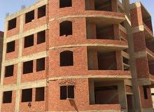 فرصه للسكن او الاستثمار في اكتوبر مبني كامل في منطقة المحوره ب