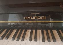 slightly  used Hyundai Piano in very good condition with certificate and chair