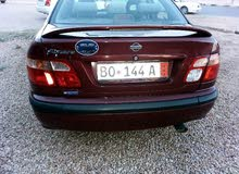 Maroon Nissan Almera 2003 for sale