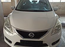 lady driven nissan tiida 2015 for urgent sale
