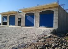4 مخازن للاجار على شارع المفرق شارع بغداد بناء جديد واجهه حجر