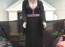 ملابس نسائية + ملكانات نسائية