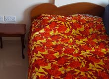 Queen size bed with mattress and two side tables