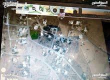 مادبا-ذيبان قطعة أرض سكنيه 1120م للبيع