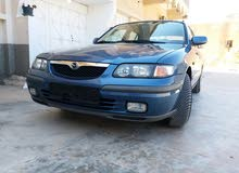Manual Blue Mazda 1999 for sale