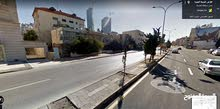 ارض استثمارية للبيع في ام اذينة شارع المدينة المنورة
