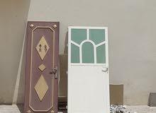بابين الومنيوم باب خشب