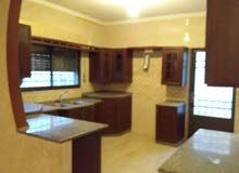 شقة طابق أرضي مع ترس مميز جداً للبيع/ أبو علندا 55