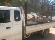 سيارة بورتر لنقل البضائع مسيجة ونشري الكرتوني