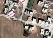 ارض للبيع على ثلاث شوارع في مؤته حي انجاصه الشرقي