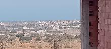 قطعة ارض مبني الطابق الارضي في مستغانم