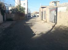 ارضيه علي الخمسين مدخل سنع امام جامع التقوي وعلى شارع 30 من الجنوب الغربي