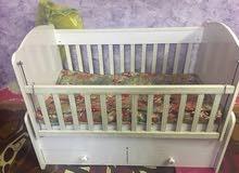 سرير اطفال هزاز مع دوشگ