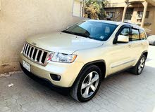 Automatic Gold Jeep 2012 for sale