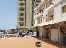 للبيع بناية في عجمان منطقة ليوارة علي شارع الميناء مقابل ديوان الحاكم والممشي بعجمان  KBH
