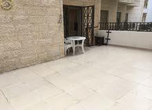 شقة ارضية مفروشة مميزة للبيع في دير غبار 80م مع ترس 50م بسعر 77000