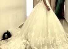 a brand new white wedding dress