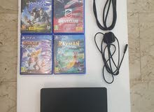 Playstation 4 slim with controller and CDsبلايستيشن 4 سلم مع اشرطة و يد