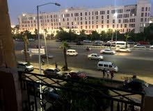 شقة بالحى السابع امام جامعة 6 اكتوبر مباشرة ناصية باقل سعر للمتر فى اكتوبر