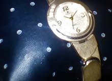 ساعة Swisros أصلية لونها ذهبي