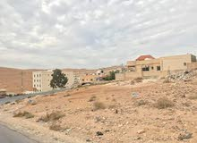 قطعة ارض مميزة للبيع في الزرقاء ضاحية المدينة المنورة على شارعين مربعة ومستوية