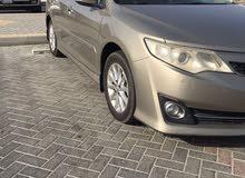 كامري 2012 للبيع ماشي 103 الف اللون بني