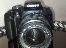كاميرا كانون 1100 للبيع معاها لشاحن ولبطايه وستاند ولشنته