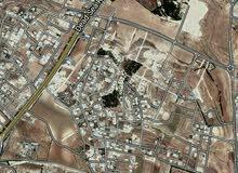 ارض تجاري 800م في شارع السلام بعد اشارة مرج الحمام