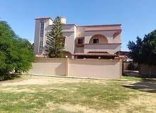 منزل للبيع واجهتين بمنطقه عين زاره بالقرب من منتزه هابي لاند مساحة الأرض 1500 م