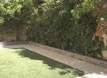 شقة ارضية مع حديقة و كراج خاص