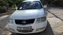 سيارة نيسان 2009 لون أبيض فحص كامل جيد + قصعات.. محرك 1600 جير عادي بور كندشن شغال حامي بارد 100%
