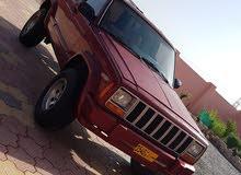 Jeep Cherokee car for sale 1999 in Al Masn'a city