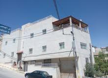عمارة للبيع في حي الرشيد طريق ياجوز مقابل مديرية التربية والتعليم للواء الرصيفة