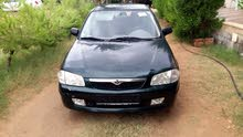 Mazda 323 2001 For sale - Green color