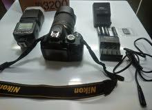 كاميرا نيكون بودي D3200 + لينس 18-140 +فلاش Triopo960