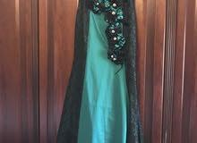 فستان سهرة لون اخضر