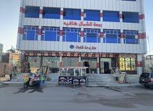 بنايهً للبيع مقابل المستشفى وقرب ملعب نادي الزبير