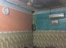 بيت للبيع حي الحسين شارع البلديه