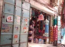 محل دورين مسلح هردي في وسط سوق تجاري باب مشرف الحديدة