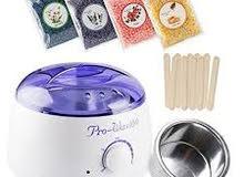 آلة الواكس لتسخين الشمع لإزالة الشعر مع حبوب الشمع مع أعواد خشبية