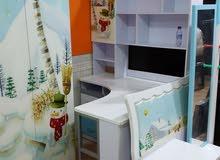 غرفة اطفال سرير واحد مكتب دولاب