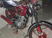 دراجة برفاز  لون ماروني اوراق