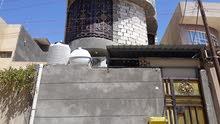 بيت طابقين 100متر بالجزيرة الفيروزية بالقرب من سيطرة جسرالجزيرة ه 07827005554