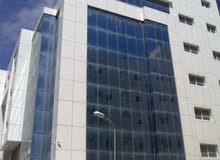 مبنى تجاري للبيع في منطقة الظهرة