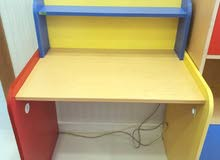 kids study table and storage cupboard